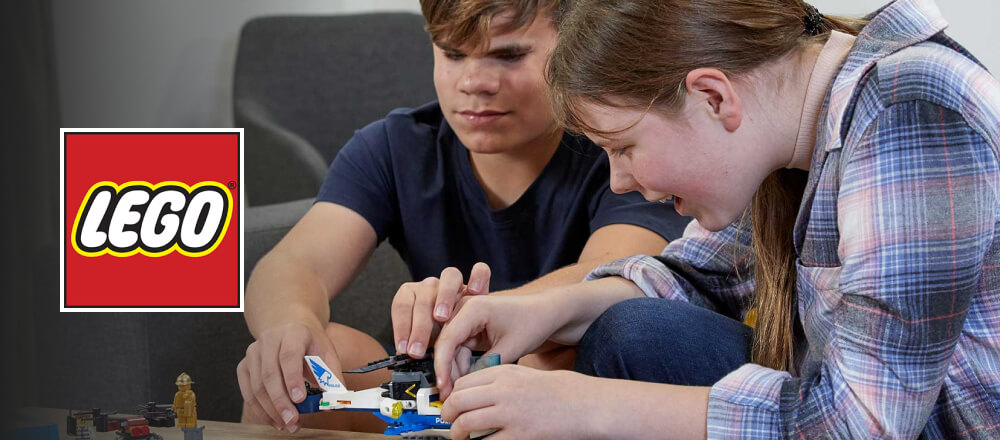 Two vision impaired kids building a LEGO helicopter while listening to the audio instructions.